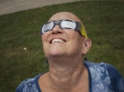 Karen Gardner with eclipse glasses.