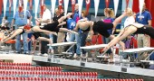 Erika Chick, second from right, took off from the starting block in the 200-yard freestyle race at last Saturday's district finals in Oxford. Chick finished in second place with a season-best time of 1:52.17 in the event, which earned her an automatic state berth. Elizabeth Malone placed first and fourth in her races and will also swim at the state finals this week. (Photo by megan Bachman)