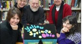 StoryBox Project ambassadors, from back, left to right, Jonatha and Harold Wright and Yellow Springs Community Library Head Librarian Connie Collett pose with the Yellow Springs StoryBox box, created by Corrine Bayraktaroglu (front, left) and Nancy Mellon. Submissions for the StoryBox project can be put into the box, on display at the library, until April 30.