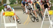 The Yellow Springs Grand Prix bike race was a blur of colors and speed last Friday, May 15, as professional bikers sped around the streets surrounding Mills Lawn School. The 5 p.m. race kicked off two days of Fling in the Springs events, which included Saturday's Yellow Springs Road Race and a Community Yard Sale. Other events included the Sundog Film and Music Festival, with a lineup of young local musicians. Fling in the Springs is sponsored by the Chamber of Commerce.