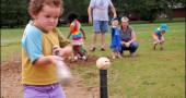 Local slugger Eliza Minde-Berman exhibited profound determination as she eyed the ball in preparation for a big hit at a recent Perry League t-ball evening. Perry League, the noncompetitive beginners' baseball program, continues each Friday evening from 6:30 until 8:30 at Gaunt Park; all local girls and boys aged 2–9, along with their parents, are invited.
