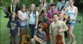 These 11 local young musicians will perform this Saturday, July 25, at 7:30 p.m. at Mills Lawn gym, as part of the annual Friends Music Camp concert in Yellow Springs. The event is a fundraiser for Glen Helen. Pictured are, back from left, Hollister Fitch, Annabel Welsh, Oona Owen, Erin Grote, Rory Papania, Joshua Seitz, Porter Fitch and Maeve Korkan-Laughlin. In the front row, from left, are Saul Fairlie, Sam Holman Smith and Noah Winold. The local youth are among more than 70 young people attending the camp, which is in its 30th year in Barnesville, Ohio. An article on Friends Music Camp is on page 7 of this week's issue.