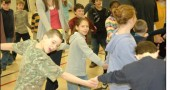 Yelping and hooting to the beat of their dancing feet this week, Mills Lawn students were helpless to resist the call to folkdance with workshop leaders Cristian Florescu and Sonia Dion, who visited the school on Friday and Monday, March 27 and 30. Professional folk dance teachers and performers from Montreal, Florescu and Dion used traditional choreography and cultural concepts of Romania, Quebec, Israel, Dominican Republic and Bolivia to foster the discovery of dance as a mode of self expression and to open the students to a global vision. Their residency was made possible by a grant from the Dayton Foundation, sponsored by Leslie Hyll and Edmund Cordray, of the Miami Valley Folk Dancers.  Above, clockwise from top, Florescu led a warm up to a delighted bunch of second and third graders, just before Nathan Davis and Kennedy Young participated in a snaking line dance to the sound of a French Canadian Farandole.