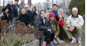 Some members of the loosely-networked community gardening group are shown in the FCC garden. Pictured from left to right are: standing, back row: Meranda Pelzl, Corinne Pelzl, Daniel L. Pelzl, Rob Content and Doug 'Thor' Bailey. Middle row, seated: Faith Morgan, Eric Johnson, Jenny Haack, Max Banaszak-Moore, Bob Moore. Front row: McKenna Banaszak-Moore and Christine O. Roberts, Sally Palmer and Paul Webb.