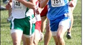 Jake GunderKline, right, was in the thick of the chase at Scioto Downs race track in Columbus during Saturday's cross country state championship meet. Gundi placed 30th overall in a personal record of 16:30.