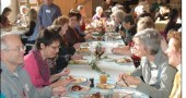 Organizers of the Yellow Springs Community Thanksgiving dinner ran out of turkey when 250 villagers, about twice the number of people as came last year, showed up last Thursday at the First Presbyterian Church. But no matter — there was still plenty of food and everyone seemed to have a good time. Shown at the near end of the table are Tom Osborne and Susan Gartner, left, with Gayle Gyure and Anne Randolph, right.