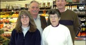 Clockwise from back left, Tom Gray, Dave Trollinger, Elma Straley, Brenda Donley and 25 other full and part-time employees help keep the shelves at Tom's Market fresh and well-stocked 365 days a year.