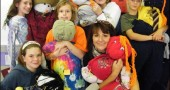 Mills Lawn teacher Wendy Shelton, bottom right, and sixth graders show off the scarecrows they recently made, which will be on display at the school's Scarecrow Festival, Friday, Oct. 9, at 2 p.m. on the school grounds. Shown with Shelton are, bottom row left, Rhona Marion, and top row, left to right, Ursula Kramer, Charlotte Snare, Madeline Neilsen and Jaron Fox.