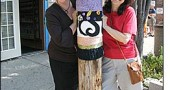 Local artists Corrine Bayraktaroglu and Nancy Mellon, aka the JafaGirls, stand behind a pole they have tagged with knit graffiti on Dayton Street. Their Yellow Springs public fiber art is featured in the new book, 'Yarn Bombing,' from Arsenal Pulp Press.