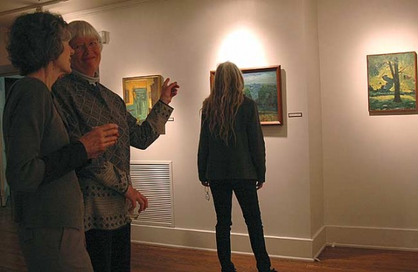 "Saturday night's opening reception of ""Robert Whitmore: A Devoted Sense of Place"" at the Antioch College Herndon Gallery. Shown are Kay Kendall with Sue Parker; in the background is Ali Thomas."