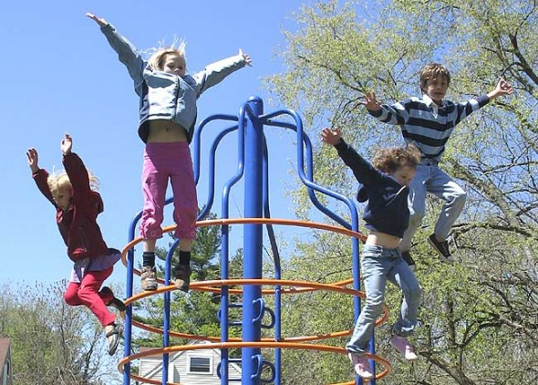 Kids leap into the blue spring sky