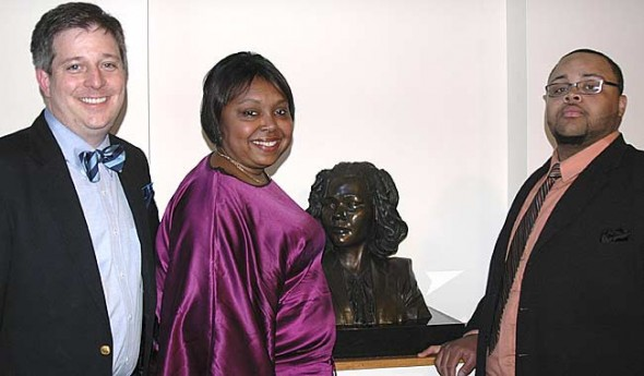 A bust of Coretta Scott King was installed Tuesday evening at the Antioch College celebration honoring Mrs. King's birthday. Shown above are, from left, Antioch College Interim President Matthew Derr, Dana Patterson, former director of the center, and Christopher Smith, senior music major form Central State University.