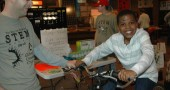 Chays Robinson, Dayton, tried out the STEM School's Energy Bike at Saturday's Green Fair. (Photo by Lauren Heaton)
