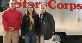 Three WYSO Public Radio employees greeted the StoryCorps mobile booth when it arrived in Dayton on Monday, April 19. Shown are Peter Hayes, director of operations, Julietta Fromholtz, Webmaster and Neenah Ellis, station manager. The StoryCorps mobile booth, which is being sponsored by WYSO, will be parked in front of the Schuster Center in downtown Dayton from April 22 to May 15, as part of a nationwide project to collect oral history.