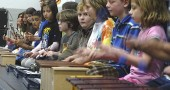 Fourth graders perform on percussion instruments for a capacity crowd at the Mills Lawn School Senior Tea, April 29. (Photo by Matt Minde)