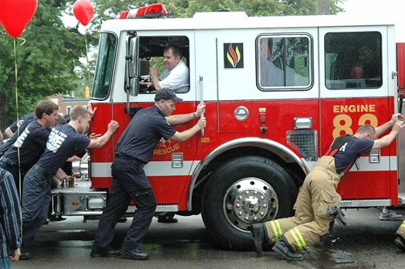 At Tuesday's open house, Miami Township firefighters carried on the tradition of pushing the new firetruck into its bay at the station. Assistant Chief Denny Powell drove the truck.