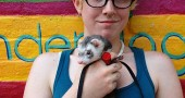 An unseasonably warm sunny day Tuesday brought villagers out to the streets, including Romy Farrar and her ferret, Grampa, who were relaxing in the pocket park between the Emporium and the Senior Center. Romy has had Grampa for two years, and he enjoys getting petted by friends and passersby.