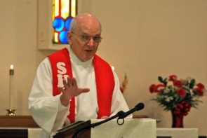 Pastor Hill gave his final sermon on the church's past successes and future plans. (Photo by Megan Bachman).