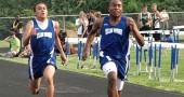 YSHS junior Mario Cosey won the 100-meter dash with Logan Norris-Sayres at his heels at the Bulldog Invitational on Friday, May 7. (photo by Nick Dudukovich)