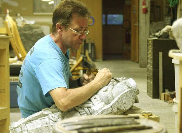 Michel Zurbuchen is shown carving in his studio, Sculptor's Emporium, which is located in Millworks. Zurbuchen offers classes to those interested in learning the art of stone carving, which he says is not that difficult. (Photo by Sehvilla Mann)