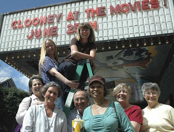 "A group of Little Art Theatre supporters organized the theater's first fundraiser, an auction gala, ""Clooney at the Movies."" While the event is sold out, villagers can still buy raffle tickets to get a year's worth of free movies. In the top row are Jenny Cowperthwaite-Ruka and Kipra Heerman, and in the bottom row, from left, are Dorothy O. Scott, Diane Foubert, John Geri, Alice Earl Jenkins, Maureen Lynch and Jane Scott. (Photo by Megan Bachman)"