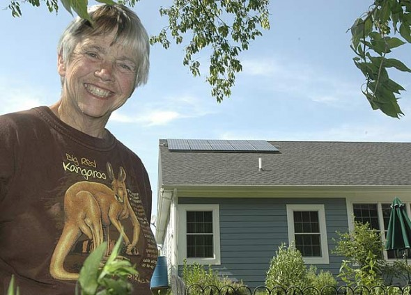 On her roof on Stewart Drive, Pat Brown's 10 new solar panels convert the sun's rays into electricity and send it to the Yellow Springs electric grid. She is the first Greene County resident to install grid-tied solar photovoltaic panels. (Photo by Megan Bachman)