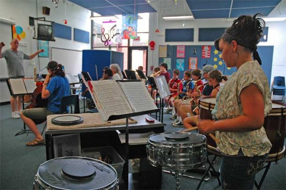 Lorien Chavez drums along with the orchestra, which is gearing up for its musical finale on Saturday.