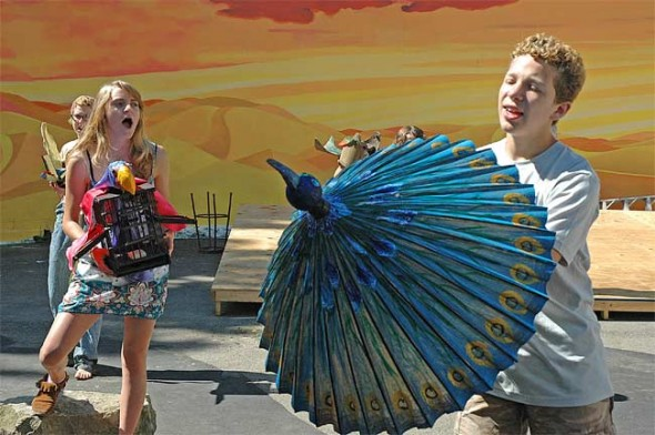 """Cast members of the latest YSKP musical, """"Conference of the Birds,"""" practice with their puppet props during rehearsal last Thursday. (Photo by Megan Bachman)"""