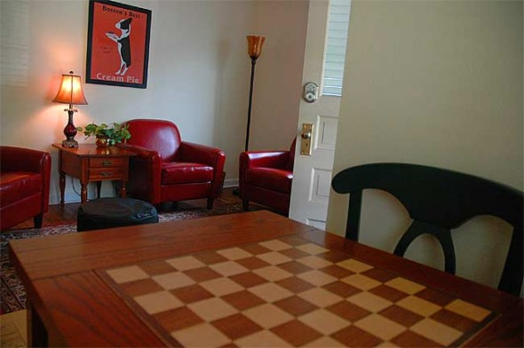The game table in the Springs Cottage living room has card games, checkers and chess.