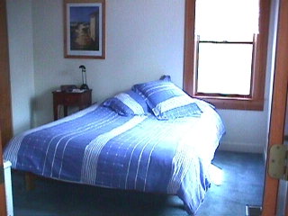 The queen bed at the YS Chalet, private apartment which can accomodate two guests.