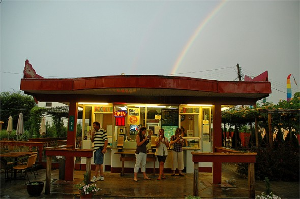 Patrons at the Corner Cone ate their ice cream unbeknownst that a full rainbow lay in the sky behind   them.(Photo by Megan Bachman)