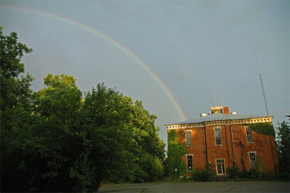 A stunning rainbow stretched behind the Union School House on Thursday night. (Photo by Megan Bachman)