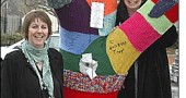 Corrine Bayraktaroglu and Nancy Mellon at the Knit Knot Tree on Xenia Avenue.