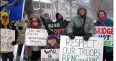 Anti-war protesters stood on the corner of Limsetone Street and Xenia Avenue as the snowstorm hit Saturday, March 8. Protesters have occupied the corner on Saturdays since 2002. Shown, from left, are an unidentified protester, Daniel Taylor, Mary Morgan, Terry Snider, Hazel Tulecke, Bill Houston, Bill Firestone and Janeal Ravindal.