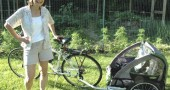 Kate LeVesconte showed off her garden and brand new bicycle carrier, which she fills with groceries from town for carbon-free transport to her home on Glen View Road. LeVesconte shares these energy conservation techniques at monthly meetings of the Ten Percent Club. (photo by Megan Bachman)