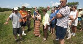 Doug Christen of Smaller Footprint Organics, a three-acre farm two miles north of Yellow Springs, shares his approach to sustainable farming at a tour of local farms organized as part of the Yellow Springs Experience by the Tecumseh Land Trust.