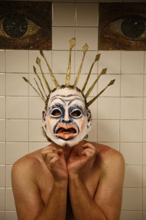 Director Mark Greenfield posed for an impromtu photo in the New York City subway shoot wearing a mask from his Oedipus Rex production. (Submitted photo by Jeff Wood)