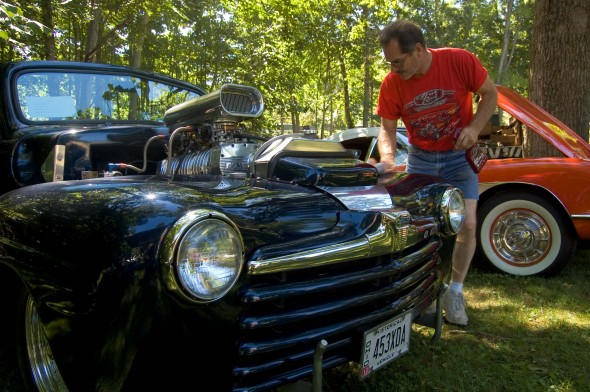Jerry Collins of Springfield tends to his 1948 Ford Convertable (photo by Aaron Zaremsky)