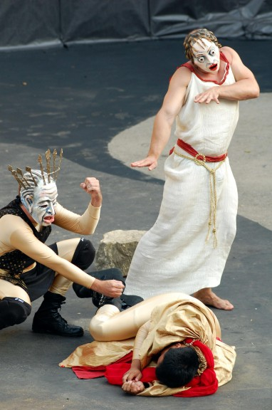Oedipus (Jamie Robert Carrillo) has his ankles spiked during the Exposition of the play Oedipus Rex (photo by Aaron Zaremsky)