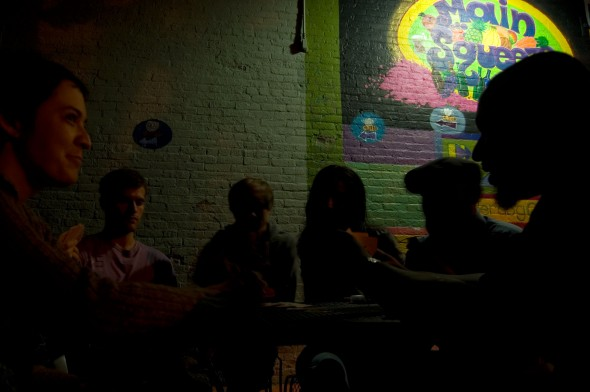 A group plays cards outside the The Underdog Cafe (photo by Aaron Zaremsky)