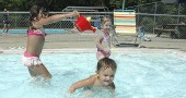 Villagers have one more chance before the end of this long, hot summer to cool off at Gaunt Park pool, which will be open regular hours this weekend before season's close at 8 p.m. on Labor Day, Monday, Sept. 6. Last Saturday the toddler pool was full of mischief, with Madeline Wall pouring water on the head of her brother, Dimitri; both were at the pool with their grandmother, Niki Sage. Behind is Lori Blankenship of Fairborn.