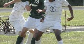 The Yellow Springs boys soccer team fell to Springfield Catholic 7–2 last Saturday, Sept. 4, at the school field, but the team put up a spirited battle. Shown above are, left, Bulldogs Eli Biggs and right, Mario Cosey, as they fought to keep control of the ball.