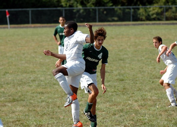 Mario Cosey goes up for a header against a Springfield Catholic Central forward during Saturday's 7-2 loss. (Photo by Megan Bachman)