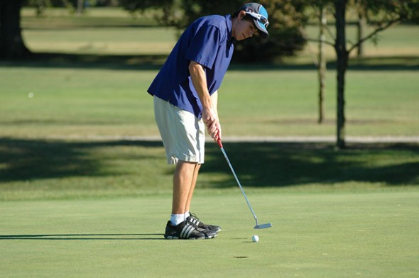 Carl Wiener knocks in his putt after a short chip put him within a few feet. (Photo by Megan Bachman)