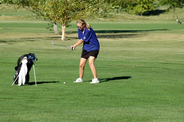 Zoe McKinley uses an iron from the fairway to put the ball near the green.