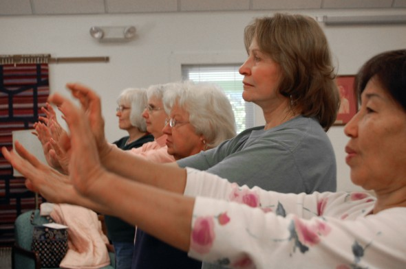 Faye Choo, Bonnie Ramsby, Bonnie Oda, Dora Voudris and Anne Whitaker practice Qigong movements at the Senior Center (photo by Aaron Zaremsky)