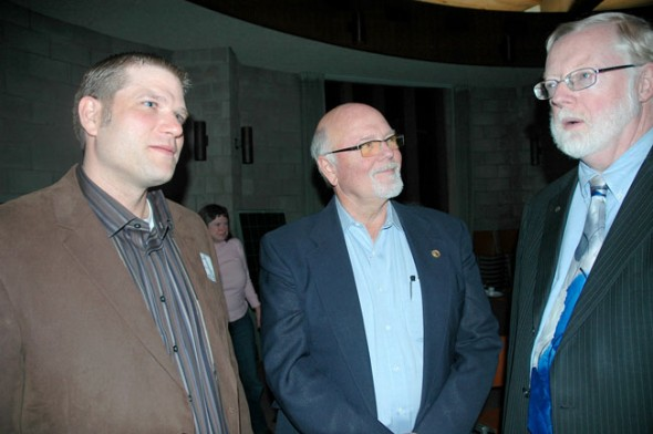 From left, Scott Lindstrom of local HVAC company, Lindstrom-Sprague Mechanical Services, and Paul Wren of Hytek Energy talk with Shanahan at the forum. Lindstrom and his wife, Shannon, have partnered with Wren to form Yellow Springs Renewable Energy. (Photo by Megan Bachman)