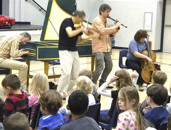 The rollicking baroque ensemble Red Priest gave a commanding performance at Mills Lawn School Monday morning. (Photo by Matt Minde; camera courtesy of Ms. Deborah Mabra)