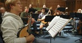 The Dayton Mandolin Orchestra recently rehearsed at the First Presbyterian Church for their upcoming Nov. 7 concert at Herndon Gallery. Foreground, Dottie Pasgrove; first row, Michael Hitchcock, Doug Daegele, Matt Minde, Yvonne Wingard and Mike Ruddell; back row, Mark Hoffman, Rose Wendel and Dwight Sutton. (photo by Megan Bachman)