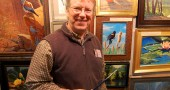 Jim Glover, who has worked with the Ohio Department of Natural Resources, shows off his paintings (photo by Aaron Zaremsky)